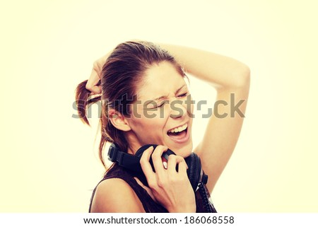 Young caucasian woman with headphones on her nack - stock photo