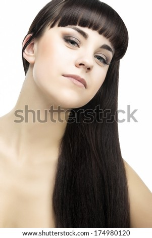 Young Caucasian Woman with Long Straight Black Hair Beauty Portrait. Isolated Over White. Vertical Image