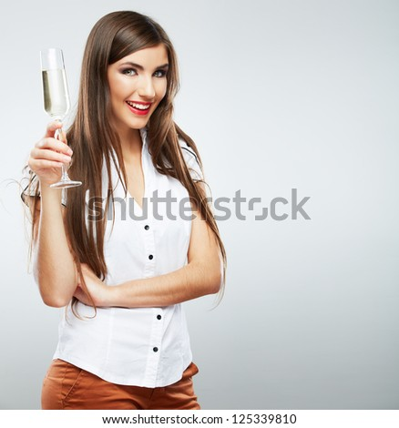Young celebrating woman . Beautiful model portrait isolated over studio background hold wine glass - stock photo