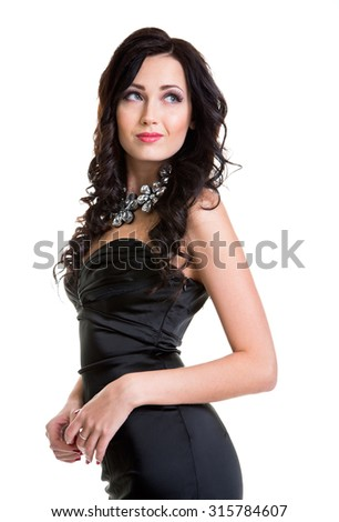 Young celebrating woman black dress . Beautiful model portrait isolated over studio background