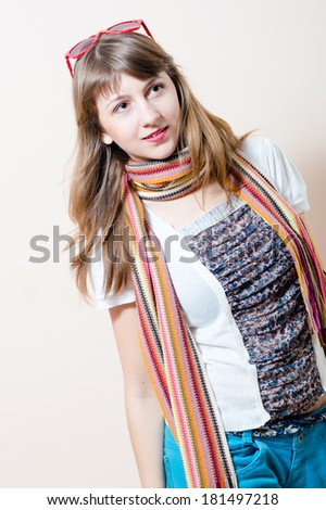 young charming beautiful woman in jeans white t-shirt with scarf glasses on head looking toward portrait - stock photo