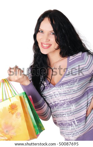 young charming brunette holding colorful shopping bags
