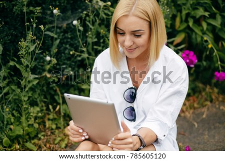 Young charming female freelancer using laptop