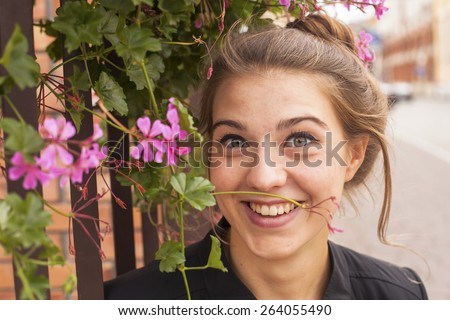 Young charming girl portrait outdoors. - stock photo