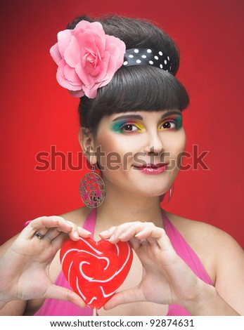 Young charming plump woman with sweets
