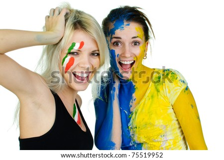 young charming women covered with paint - stock photo
