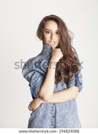 young cheerful brunette teenage girl on white background smiling - stock photo