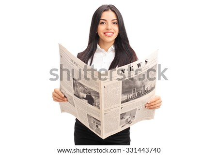Young cheerful businesswoman holding a newspaper and looking at the camera isolated on white background - stock photo