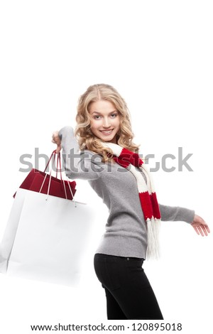 young cheerful casual blond woman holding  shopping bags isolated on white - stock photo