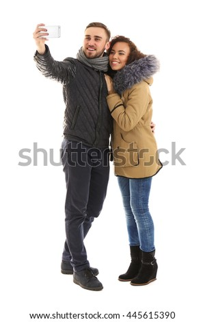 Young cheerful friends taking selfie isolated on white - stock photo