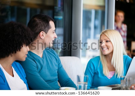 Young cheerful friends talking - stock photo