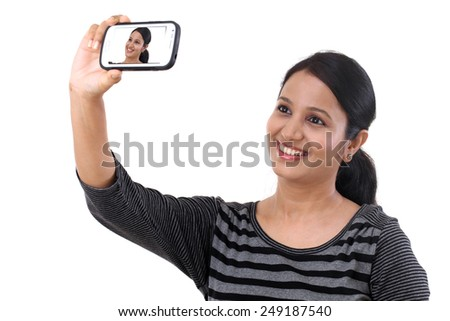 Young cheerful girl taking selfie - stock photo