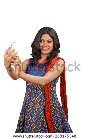Young cheerful girl taking selfie