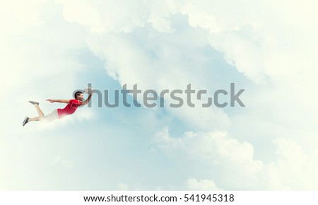 Young cheerful man flying high in sky