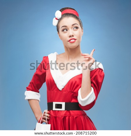 young cheerful retro girl in red vintage dress holding shopping bags - stock photo