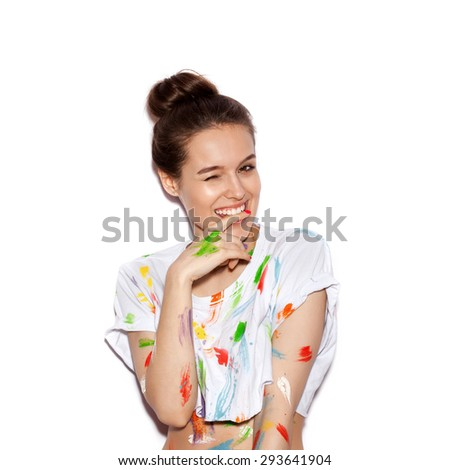 Young cheerful soiled in paint girl having fun. Smiling Woman with bright makeup and hairstyle on White background not isolated
