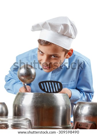 Young cheerful teenager humor in a chef's hat. He plays the drums, pots. Isolated on white - stock photo