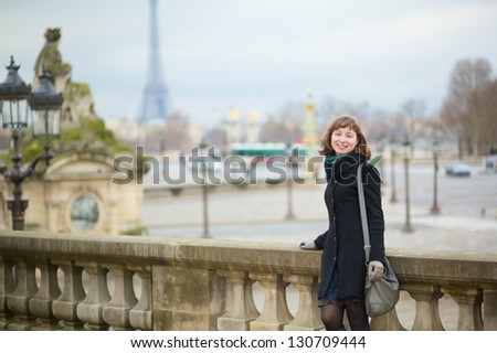 Young cheerful tourist in Paris - stock photo