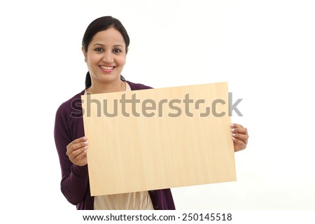 Young cheerful Woman holding blank wood sheet - stock photo