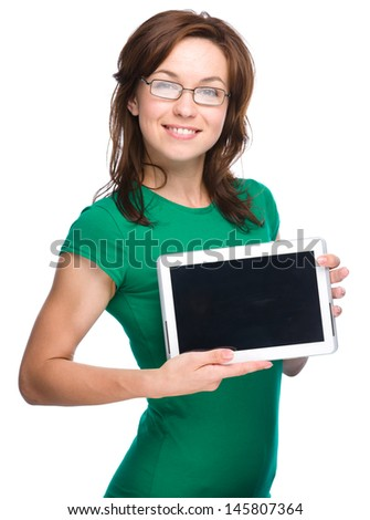 Young cheerful woman is showing blank tablet, isolated over white - stock photo