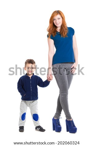 Young cheerful woman with a little boy. Isolated on white - stock photo
