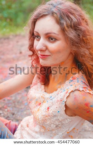 Young Cheerful Woman with Holi Paint