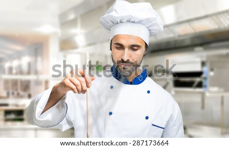 Young chef cooking - stock photo
