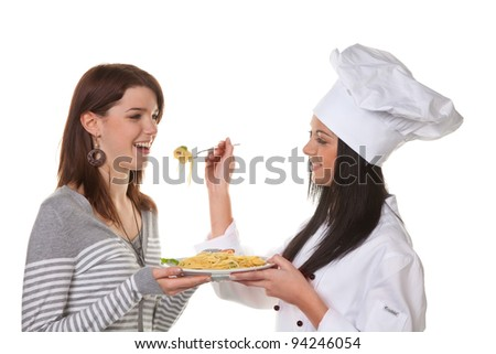 young chef tried her home-cooked pasta dish from - stock photo