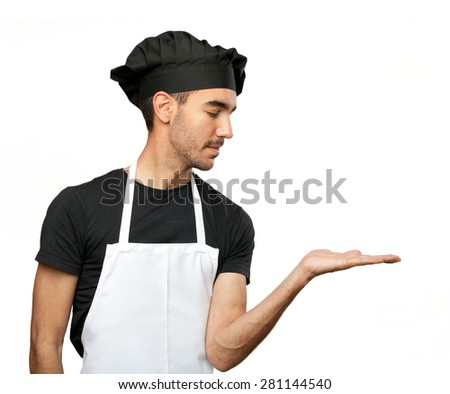 Young chef with show gesture - stock photo