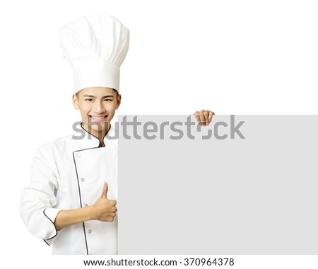 young chef with thumb up and showing  empty board   - stock photo