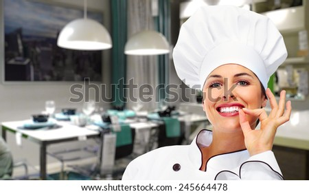 Young Chef woman in modern restaurant. Food. - stock photo