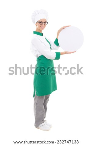 young chef woman in uniform holding big  tray with copy space - full length isolated on white background - stock photo