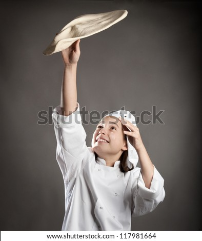 young chef working the dough for pizza - stock photo