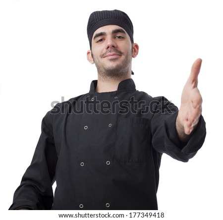 Young cheff shaking hand on white background - stock photo