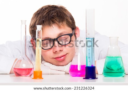 Young chemist sleeps in the lab - studio shoot