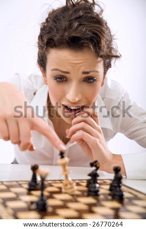 Young chess player losing a game - stock photo