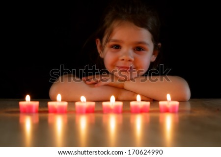 Young child and candles - stock photo