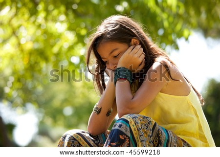 Young child at the park with a depression - stock photo