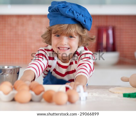 Young child baking in the kitchen - stock photo