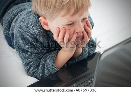Young child browsing the internet - stock photo