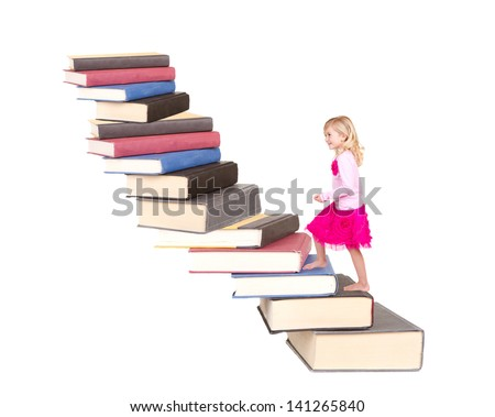 young child climbing a staircase of books with an isolated white background