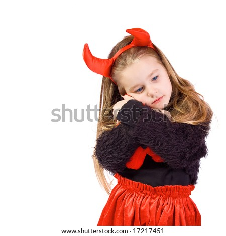 Young child dressed in a devil costume on white background