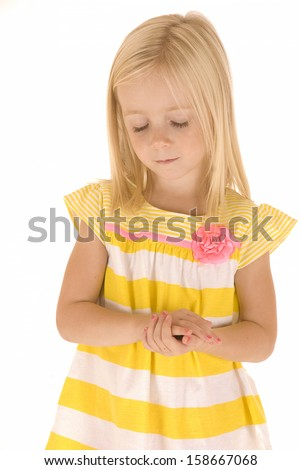 Young child eyes closed hands folded praying