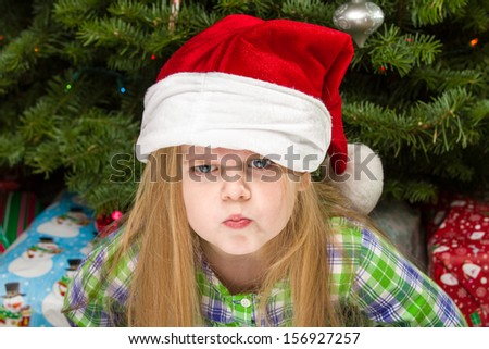 Young child giving a dirty look during christmas time.