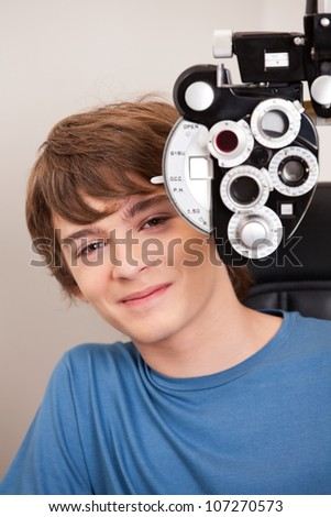 Young child having his eyes tested