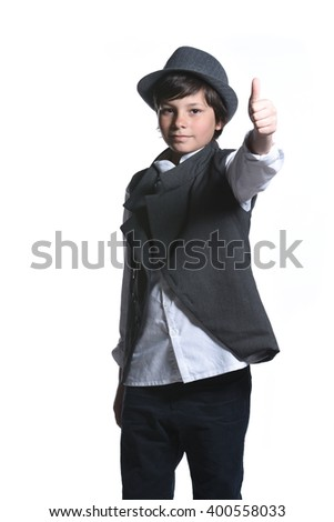Young child in formal wear showing thumb up isolated on white background