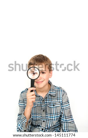 Young Child Looking at you Through Magnifying Glass - stock photo