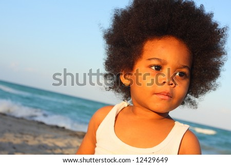 Young child looking sideways - stock photo
