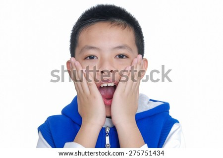 Young child surprised with hands on his face - stock photo