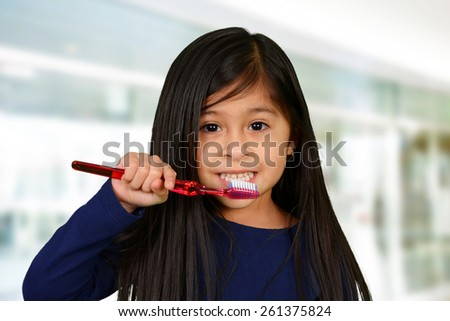Young child who is brushing their teeth - stock photo